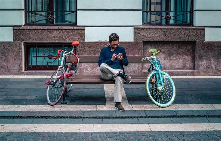 man using a bike share app
